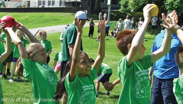Photo by Jason Kaplan Cornwall-on-Hudson Elementary School held their annual field day on June 2. One of the activities had the students pass a number of balls and Frisbees down a line, first between their legs, then over their heads. Fourth graders Elaina DeGrote, Zyanya Aguilar, and Eli Shrem made quick passes to their classmates.