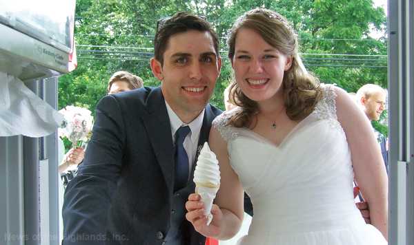 "Photo by Ken Cashman Less than two hours after they said ""I do,"" the bride and groom slipped away from their reception and ordered vanilla ice cream cones at Weir's. Blake McGready and Emily Zwart were married at the Bethlehem Presbyterian Church on July 1.  The bridal party followed them to the ice cream stand."