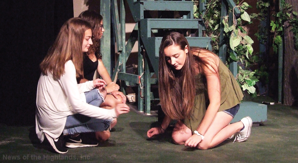 "Julia Samuelson and Sophia Cappa (Cinderella's narrators and Maggie Kelly (Cinderella), rehearse a scene from ""Into the Woods."" The performance is this Friday and Saturday."