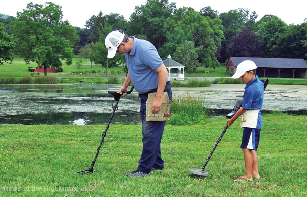 Photo by Jason Kaplan Steve Montone and his grandson, Dylan Torado, recently spent a morning searching for buried treasure around Ring's Pond. Unfortunately, all they found was some foil and loose change.