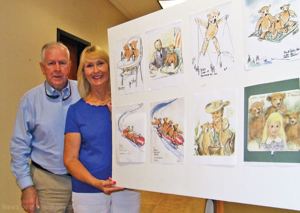 Robert and Loretta Gould with the sketches that inspired a children's book. Mrs. Gould named the central character Barnaby Benjamin Bear.