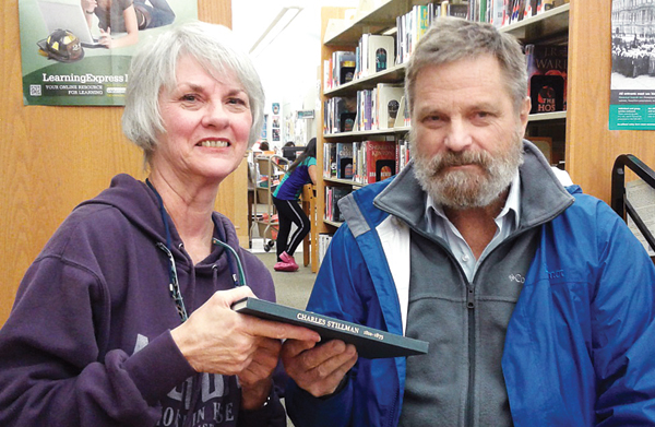Contributed photo Village historian Kathleen Christensen with Nathaniel Stillman, who donated his family's genealogical book to the museum at Village Hall.