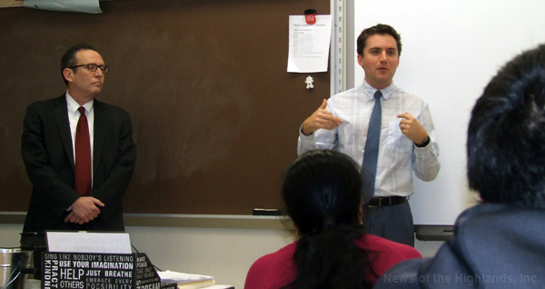 Assistant Attorney General Gary Brown (left) listens as Assemblyman James Skoufis speaks to a class at Monroe-Woodbury High School on Nov. 28.