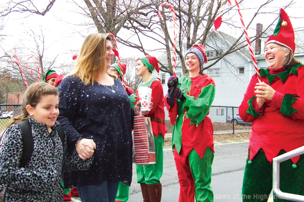 Photo by Jason Kaplan Elves lined up outside Cornwall-on-Hudson Elementary School to greet students, and parents, on the last day before winter break.