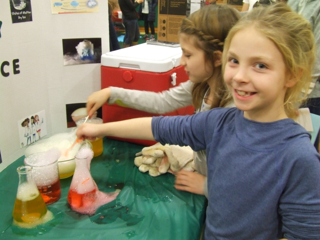 WORTH A SMILE: Kaylen Aubin and Haley Garulli proved that it's fun to make fog and bubbles from dry ice.
