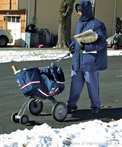 Photo by Jason Kaplan Steven Davis, a carrier with the United States Postal Service, has been enduring the recent frigid temperatures while making his daily deliveries. His secret to staying as heated as possible is warmers in his gloves and sneakers, three layers plus a coat for his upper body, as well as an additional layer under his heavy pants.