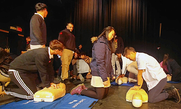 Photo contributed Storm King School students practiced CPR during a demonstration.